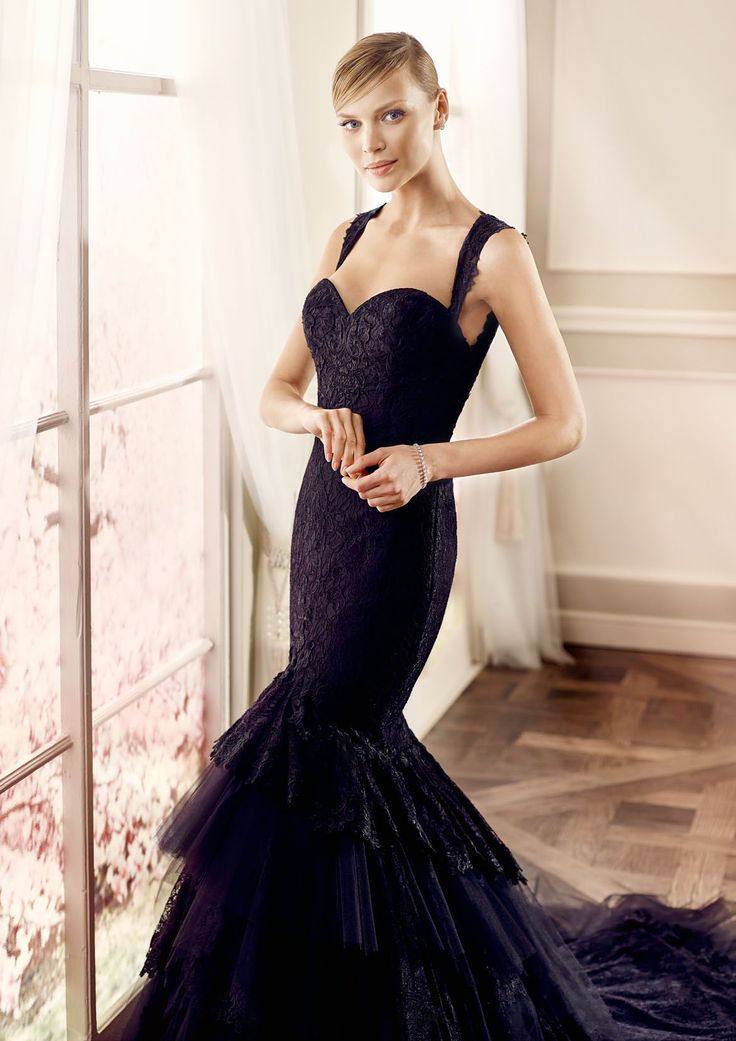 Modeca black Swan design from LePapillion collection. Statement black lace sleeve sweetheart bodice design. Full lace back. Figure hugging mermaid gown with dramatic train.