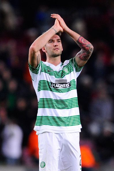 Charlie Mulgrew of Celtic FC acknowledges Celtic FC supporters at the end of the Champions League Group H match between FC Barcelona and Celtic FC at Camp Nou on December 11, 2013 in Barcelona, Catalonia.