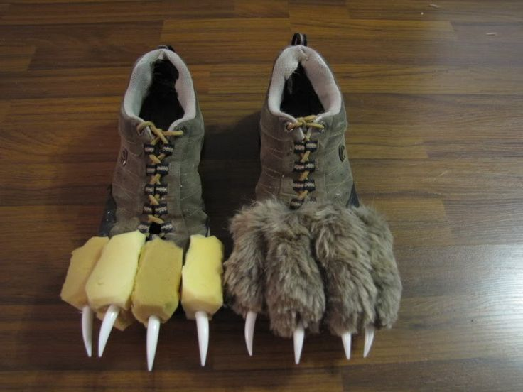 Use an old pair of shoes, some yellow foam from a craft Store, and some Halloween 'teeth' meant for jack-o-lanterns we got at the dollar store. Then later covered it in fur.