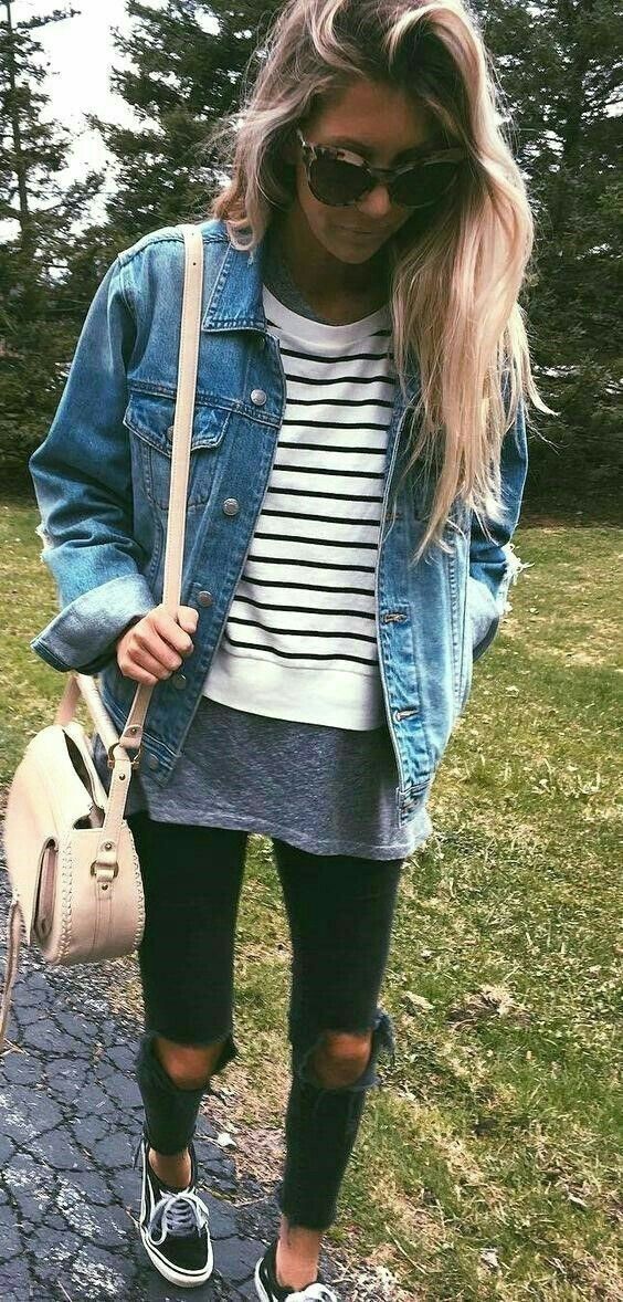 Distressed black skinny jeans with striped crew neck sweater and medium wash jean jacket plus vans