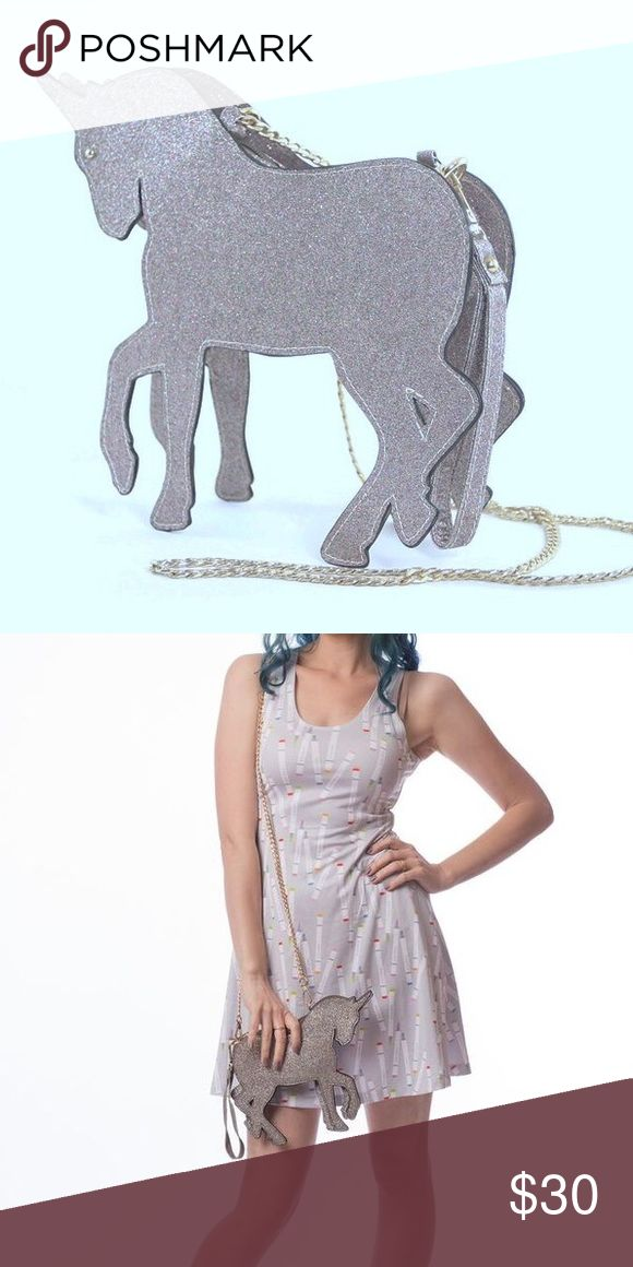 """Glitter unicorn purse / wristlet Glitter unicorn purse! Featuring a zippered closure, lined interior, a 21"""" detachable chain, and a 5"""" wrist strap to allow you to wear this as a purse or clutch, this nifty bag measures approximately 7.25"""" x 3"""" x 9.4""""      *the zippered pocket of this bag however is pretty small (so really only enough room for a phone, small keys, and cards or cash* Lace & Lore Bags Crossbody Bags"""