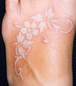 white foot tattoo. i want a white ink tattoo so bad!