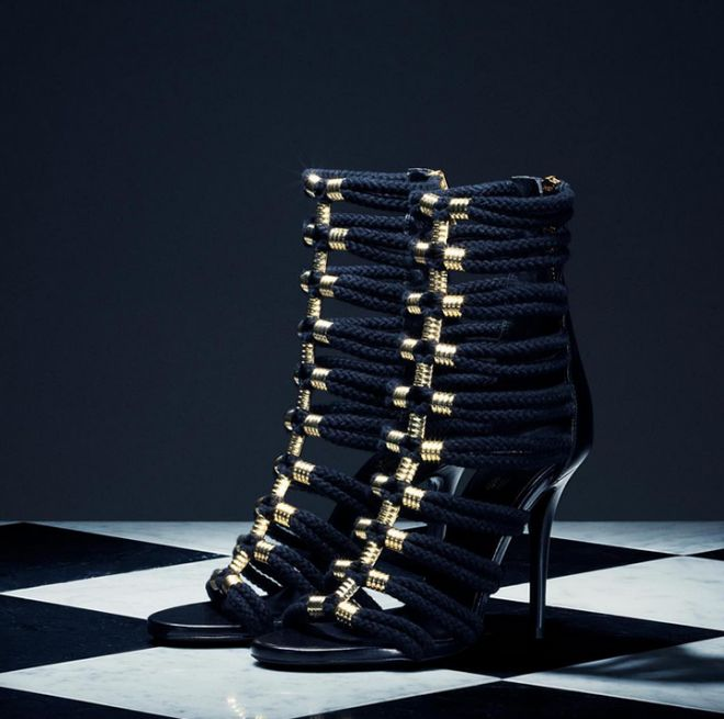 Balmain brings their signature style to the H&M collaboration collection with these gorgeous black and gold strappy heels.