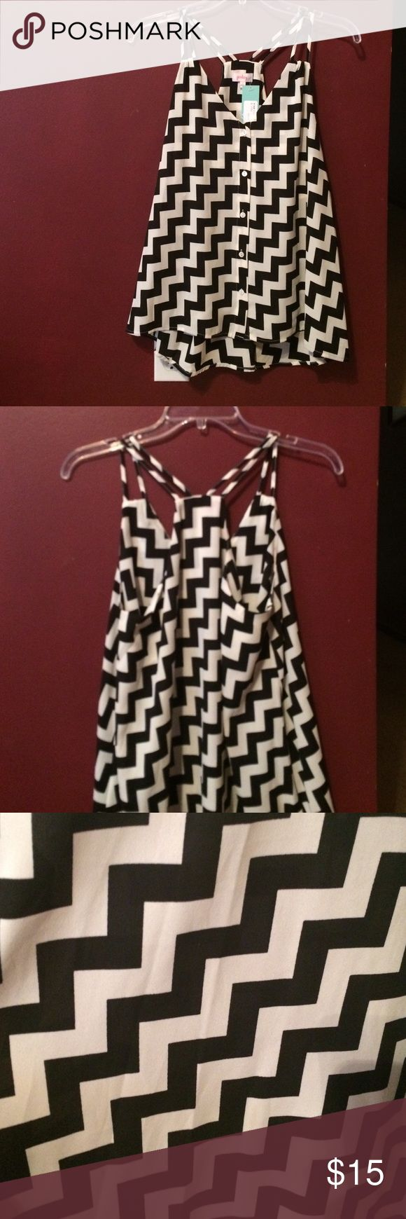 Beautiful geometric strappy top Beautiful new with tags black and white geometric print top by Pixley. 100% polyester Pixley Tops