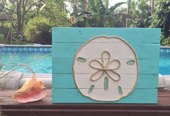 This beachy piece of art is made from reclaimed pallet wood and is perfect for a nautical inspired beach house! Each sign is hand cut, hand sanded and hand painted. Each sign is made to order so no two will be exactly alike due to variations in the wood. All signs have a cable wire on the back for easy hanging. Dimensions are approximately 23 x 16 1/2 inches.