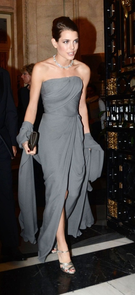 Charlotte Casiraghi wearing a grey silk chiffon, draped bustier gown, and matching shawl from Elie Saab