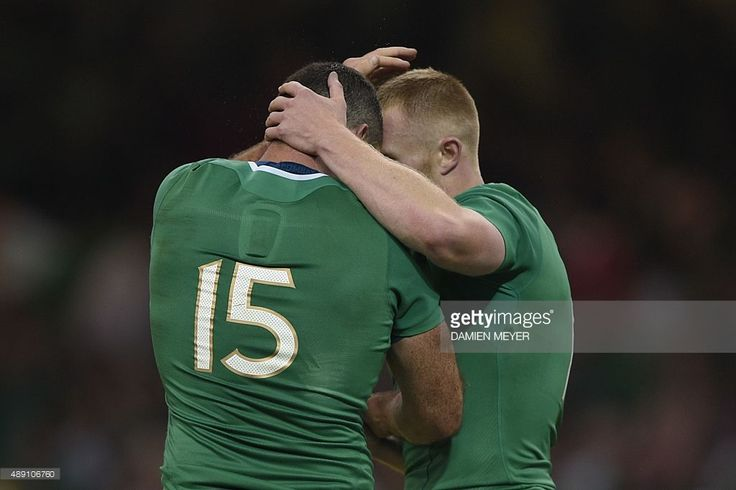 Ireland's full-back Rob Kearney (L) celebrates after scoring a try with Ireland's wing Keith Earls during a Pool D match of the 2015 Rugby World Cup between Ireland and Canada at the Millenium stadium in Cardiff, south Wales on September 19, 2015. STILLS