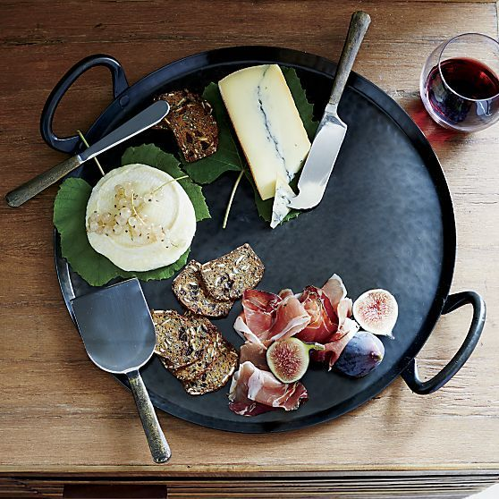 Our Feast platter is a great way to serve appetizers, finger foods or ethnic specialties to a big group with high-impact style. Each large-scale server is handcrafted from iron, hand-hammered into its own unique pattern. Practical sturdy loop handles complete the traditional look.