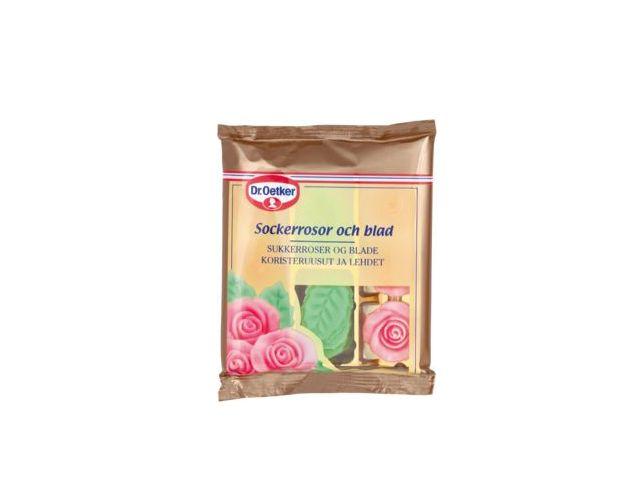 Sockerrosor och blad. Dekorera din tårta eller bakelse med vackra rosor och blad tillverkade i mjuk sockermassa. En förpackning Dr. Oetker Sockerrosor och blad innehåller 6 st rosafärgade rosor och 12 st grönfärgade blad.