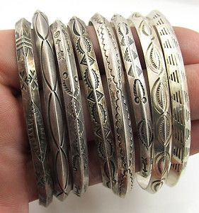 Eight sterling silver Native American cuff bracelets made with stamped triangle wire.
