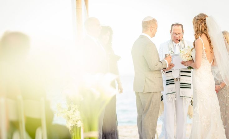 Beautiful shot of bride and groom at their beach wedding | Palace Resorts #destinationwedding
