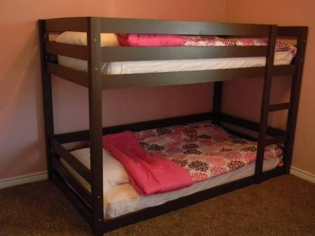 diy bunk bed plans...I like that the one on bottom is pretty much on the floor! I'm doing this next year when Bristyl moves out of her crib!