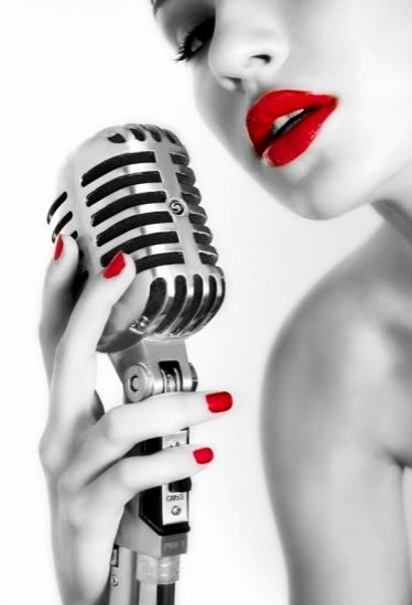 Lady with red lipstick holds the microphone. #mics #microphone #Music http://www.pinterest.com/TheHitman14/headphones-microphones-%2B/