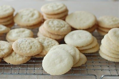 Best sugar cookies ever!  They're so thin and crispy and you can eat a billion in one sitting.  Use cinnamon when you press them to give them a snikerdoodle feel.