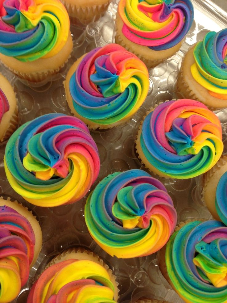 Get crazy with colour and decorate your vanilla cupcakes with a stunning rainbow swirl!