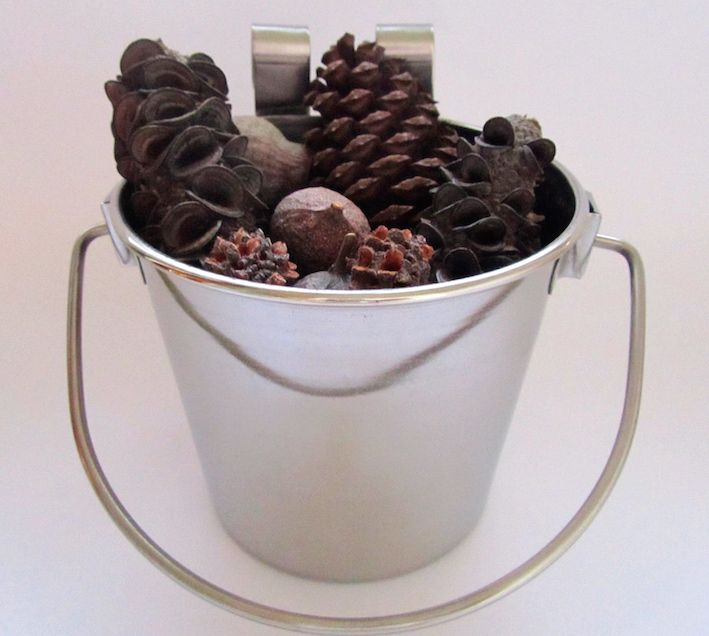 Save your parrot from boredom! This pack includes a heavy duty flat sided stainless steel bucket filled with a mixed assortment of Australian natural seeds and pods - large sized gumnuts, casuarina seeds, banksia pods and pine cones. Available from: www.onestopparrotshop.com