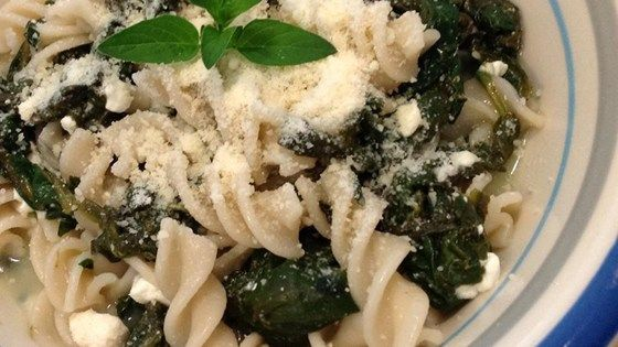 Spinach is sauteed with garlic, then tossed with egg noodles and cottage cheese in this easy and delightful pasta dish.