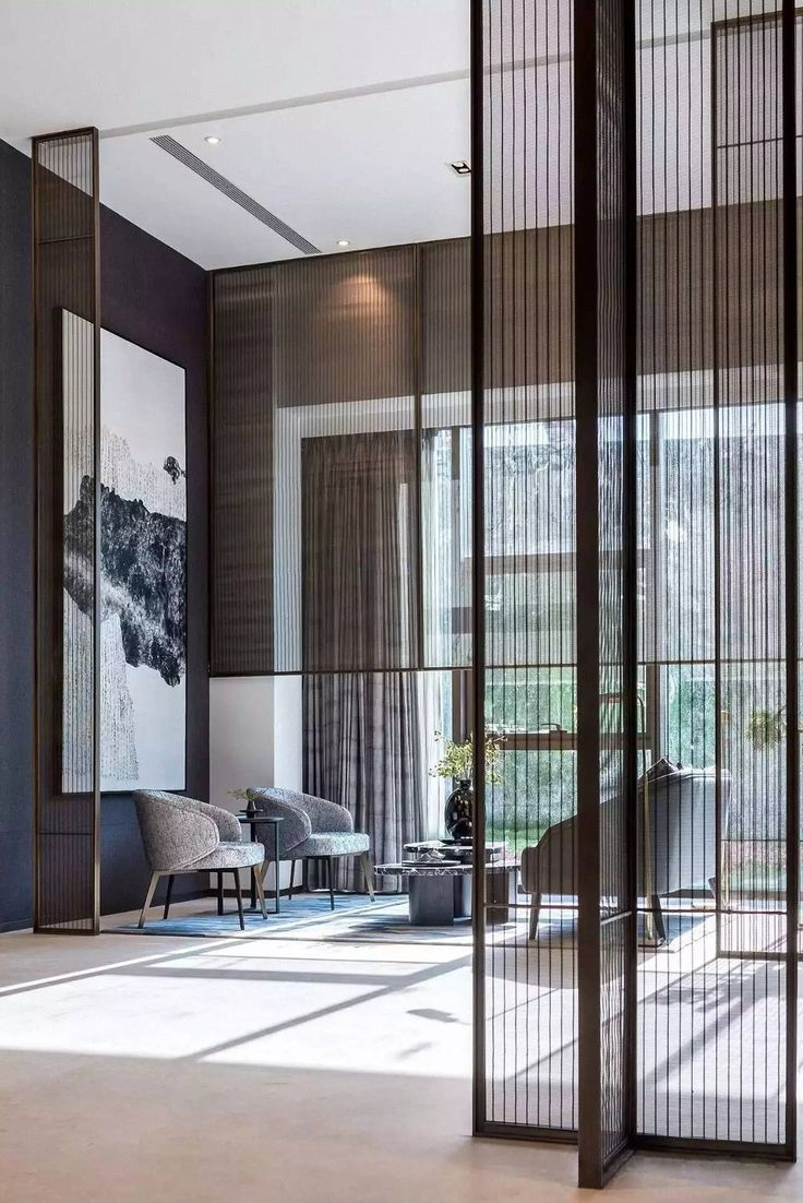 GENIOUS METAL SCREEN AT WINDOW TO MAKE THE SPACE MORE COMFORTABLE/ COSY