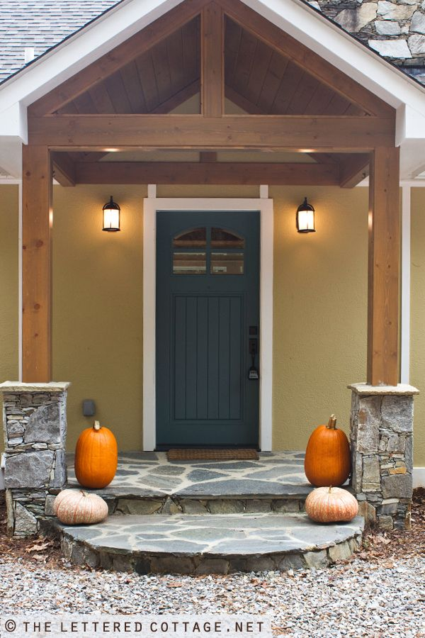 Tuscan yellow deep blue creamy white trim and stained for Natural wood front door
