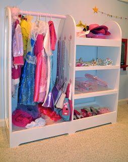 Adventures in Tullyland: Project Playroom: Storage. Love this dress up clothes storage rack and shelves!