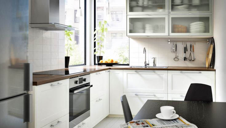 Modern white kitchen with GRYTNÄS fronts and glass doors
