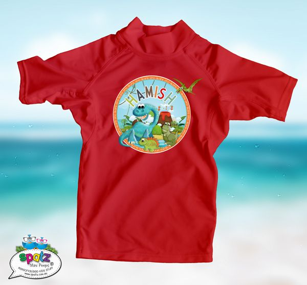 Dinosaur Island! Make a real SPLASH with our awesome range of Personalised Kids Swim Rashies / Sunshirts. SPATZ Mini Peeps®  Personalised Rashies are made from a quality 200gsm Nylon Spandex blend making them super stretchy. - Excellent sun protection with a UPF rating 50+ - Chlorine Resistant - Made from Nylon Spandex  really stretchy