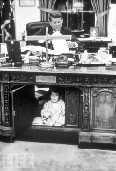 A memorable scene from Camelot: John-John plays under his father's desk, October 1963.