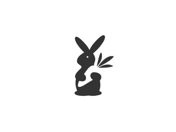 The Ultra Linx  [This cute graphic also combines two images using negative space to depict a rabbit holding a carrot. the shapes are obvious and appealing, and the logo would work on varying scales. The use of an achromatic colour scheme is effective in creating an immediately recognisable image.]
