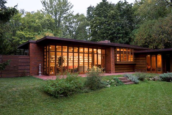 "Frank Lloyd Wright: Jacobs House, 1936. Example of FLW's ""Usonian"" style of homes emerging from the earth, opening up to nature's elements vs. boxes with scattered windows and doors, built of wood, clay."