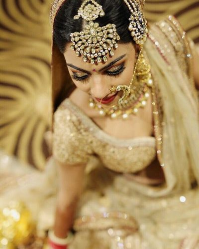 Maang Tikka - Gold and Yellow Stone Maang Tikka with Matching Passa and Nath | WedMeGood #wedmegood #indianbride #indianwedding #passa #maangtikka #nath #gold #stones