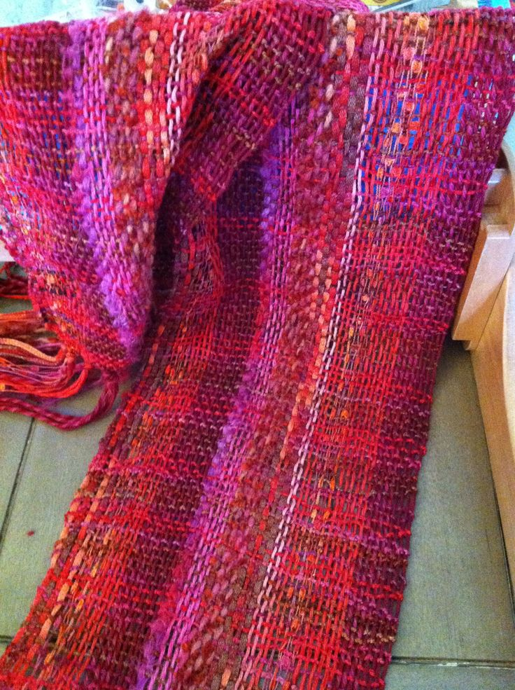 Handwoven scarf using 5-7 yarns for warp and one for weft on rigid heddle loom.