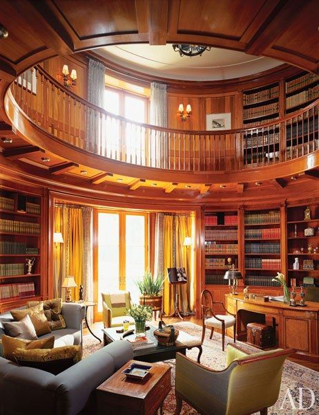 """It """"makes vague reference to the classical Ionic order,"""" Katherine Newman says of the library in a postmodern Toronto house she designed with architectural designer/builder Peter Cebulak. The room's finely carved capitals are complemented by a great number of noteworthy antiques, among them a circa 1790 satinwood worktable."""