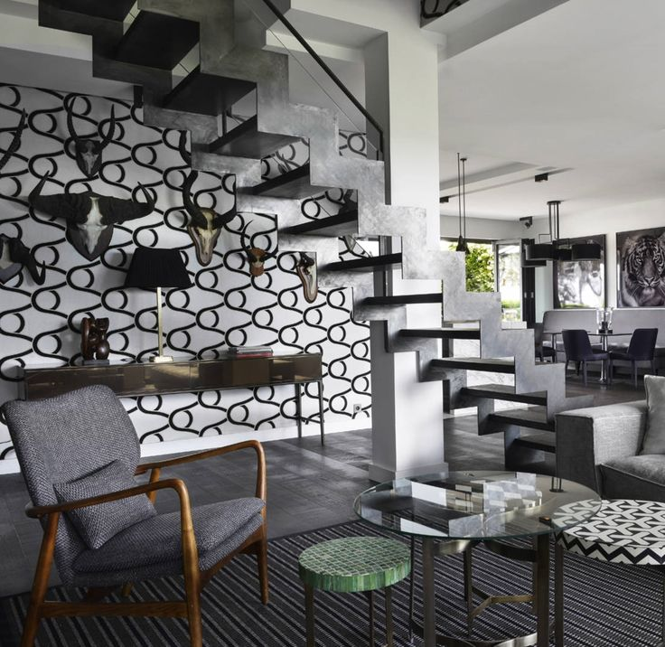 The uber industrial, chic and modern feel of this living space is off the charts! We love how they have incorporated our Hartley & Tissier Flatweave PNUK Black into this living space.