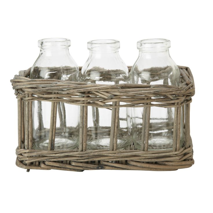 Looking like a trio of cute milk bottles in a wicker storage basket, this set of three bud vases will show off your favourite blooms.