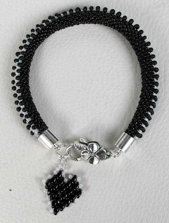 Black and white bracelet caterpillar differently with von Mulinka