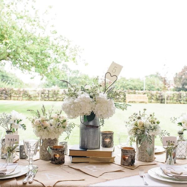 Silver Milk Churns will make the perfect containers for your wedding table centres if you are going of a relaxed country rustic feel, fill them with fresh flower available to buy from The Wedding of my Dreams #weddinginspo  #weddingideas #ukwedding #forsale