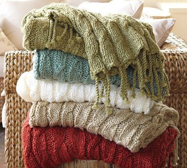 I just love this simple, repetitive throws knit with a very thin yarn. I wonder if I have some stash yarn that I could use to make one.