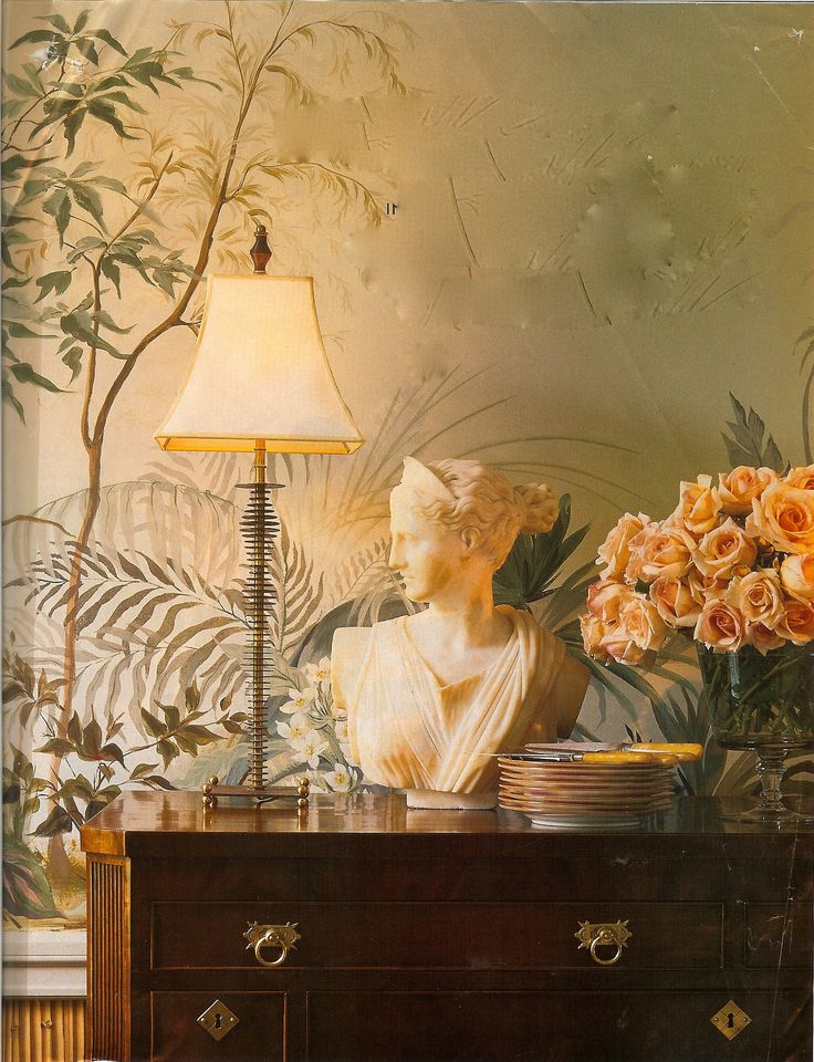 Mural, sculpture, antique chest, fresh flowers,.......amazing together.