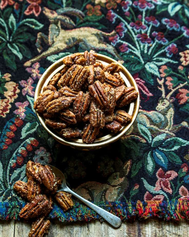 Sassy Spiced Pecans Super-fresh pecans and spices in this simple recipe take a perennial Southern favorite from the ordinary to the sublime. Have these treats out on the counter in a pretty bowl when guests arrive; with a big meal like this, why bother with elaborate appetizers? Yields 3 cups   3 cups pecan halves 1 cup coarse organic cane sugar 1 teaspoon sea salt 1 teaspoon chipotle chile powder 1 teaspoon ground Saigon cinnamon 1 teaspoon Mexican vanilla