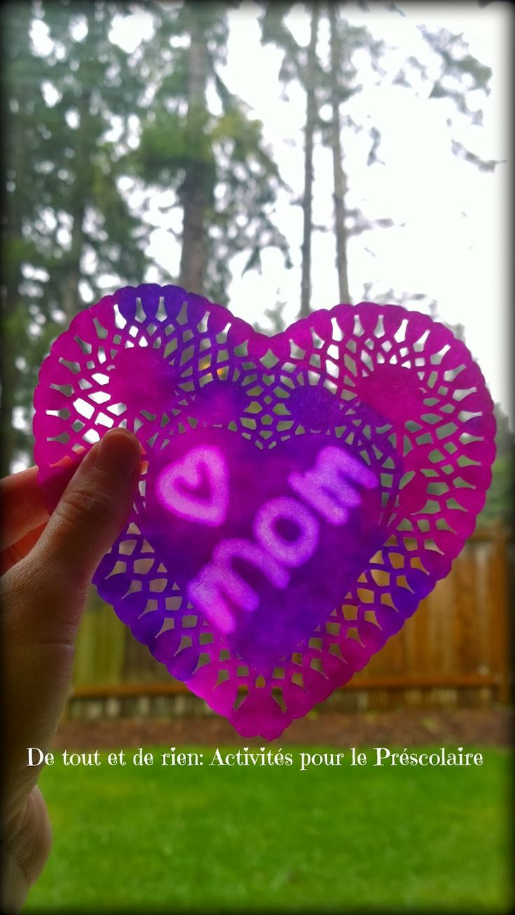 Paper doily craft for Valentine's day! Kids use a q-tip to write a message  in oil, blot, paint with water colors, and let dry.