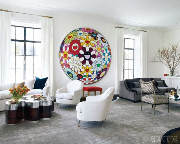 Drawing Room Painting Idea with grey fur carpet also white wall round floral colorful painting and sofas tab