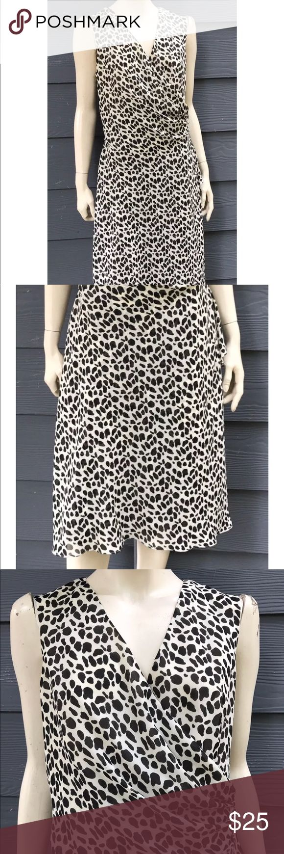 """DONNA RICCO Women Dress Black White Top Wrap Sz 14 DONNA RICCO Women's Dress Black White Animal Print Top Wrap Sleeveless Ruching Side Sz 14  Measurements laying flat approximately: Armpit to armpit 21 1/2"""", waist 18"""", hips 22"""", length 42"""".  THIS GORGEOUS DRESS HAS BEEN A DISPLAY AND TRIED ON AND OVERALL IS IN GREAT CONDITION!  NOTE:  PLEASE REVIEW MEASUREMENTS CAREFULLY BEFORE PURCHASING THIS ITEM SINCE SIZES SOME TIMES ARE DIFFERENT FROM BRAND TO BRAND. Donna Ricco Dresses Midi"""