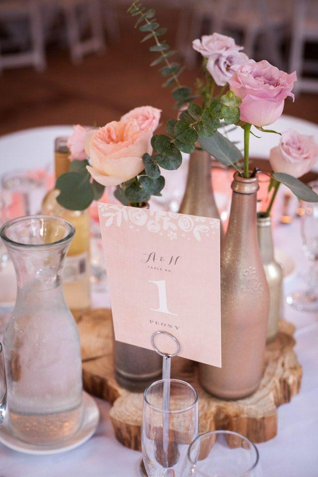 Diy painted gold glitter wine bottle wedding centerpiece for Wine bottle wedding centerpieces
