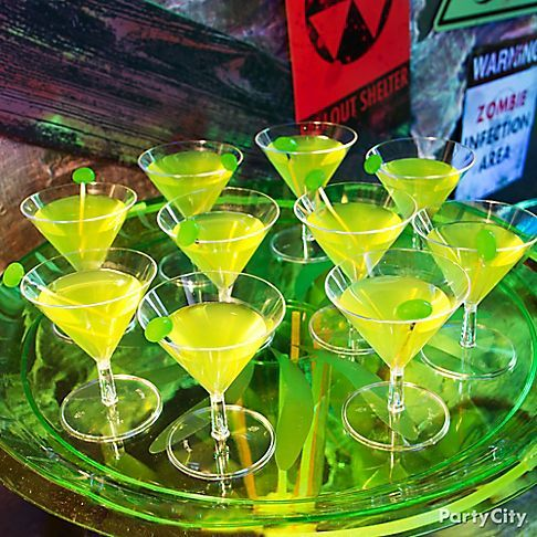 Craft this contaminated Fallout Fizz for your undead crowd! Mix Midori & vanilla-flavored vodka in a shaker, then pour into a glass. Add a splash of sweet & sour, a little lemon-lime soda & serve!