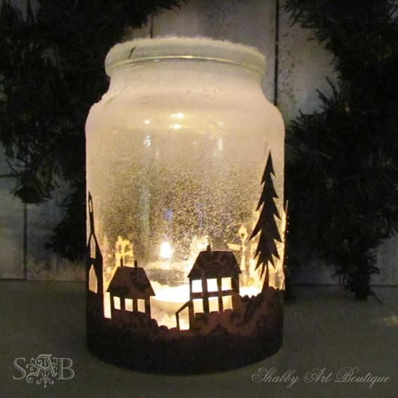 "Illimunate your home with these winter wonderland-style candles. Use a craft knife to cut out the silhouette of some trees and buildings from construction paper. Make sure the total width and height of the cut-outs fit the circumference and height of the your jar. Use glue and Epsom salt to give your candle some ""snow.""  Then wrap the paper silhouette around the jar and secure it with some hot glue. Place a tea candle in the jar for a cute addition to your holiday decor. ..."