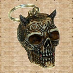 Tribal skull with horns keyring is bone coloured with a dark wash and a splash of colour to highlight the skulls details.It hangs from a small silver coloured chain and Ring.    Height : 4 cm    Width : 3 cm    Length : 4 cm    Weight : 50.00g    Made from resin    Ref : SDNEM20604   Price : 34.99 GBP