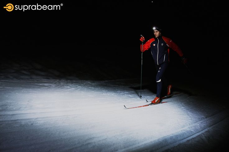 Skiing with the Suprabeam V3pro rechargeable headlamp for optimal lighting.