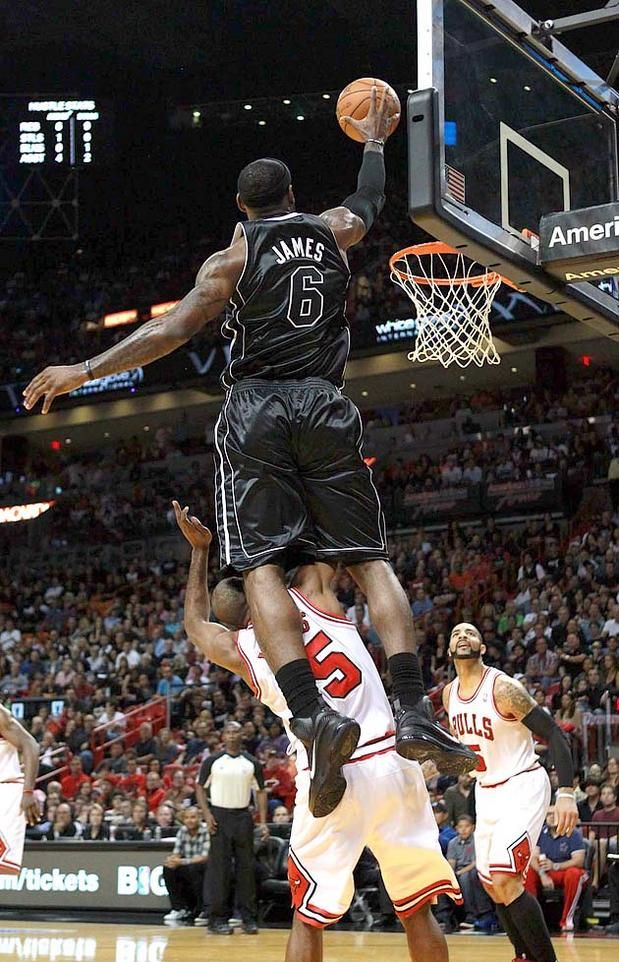 Lebron James soars over John Lucas on an alley-oop dunk.