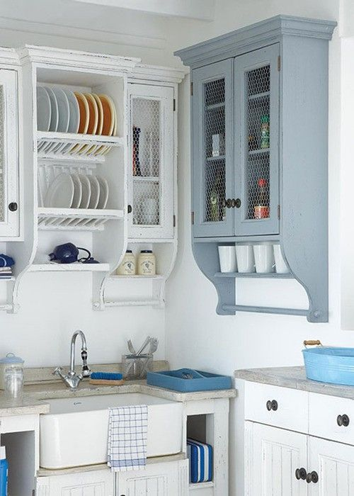 Like the plate rack over kitchen sink including towel rails. Like the blue cupboard style also. like the farm sink and cupboards.