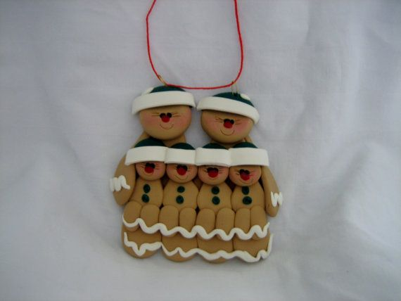 Gingerbread family of 2 adults with 4 children or can be a unique gift for grandparents with 4 grandchildren. Ornament measures 3 inches by 3